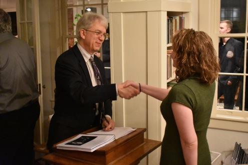 dean-handshake-from-side