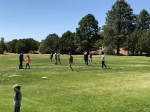 The kickball game in an early inning. The teams where randomly divided based on the ending digits of a raffle ticket.